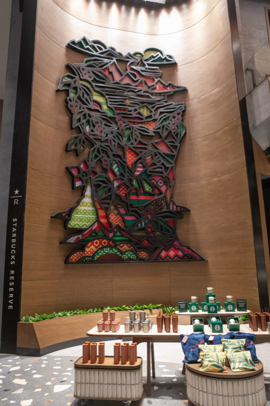 Starbucks Reserve Chao Phraya Riverfront - Colorful mural at the entrance by artist Rukkit Kuanhawate depicts Rukkit Kuanhawate