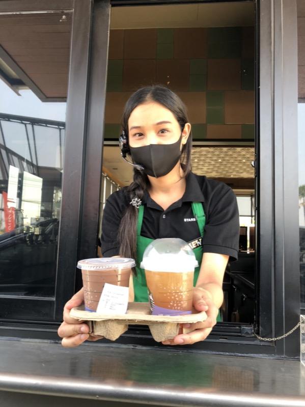 Starbucks partner at drive-thru